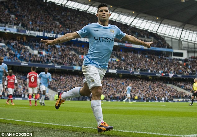 Wheeling away: Aguero celebrates his early goal to give City the lead at the Etihad