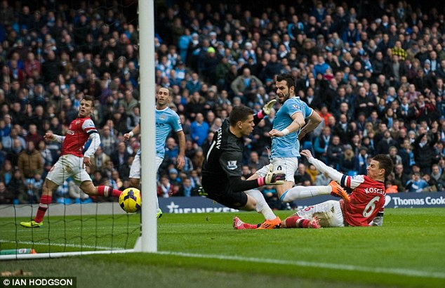 Back in front: Alvaro Negredo slides in to convert Pablo Zabaleta's cross to give City a 2-1 lead