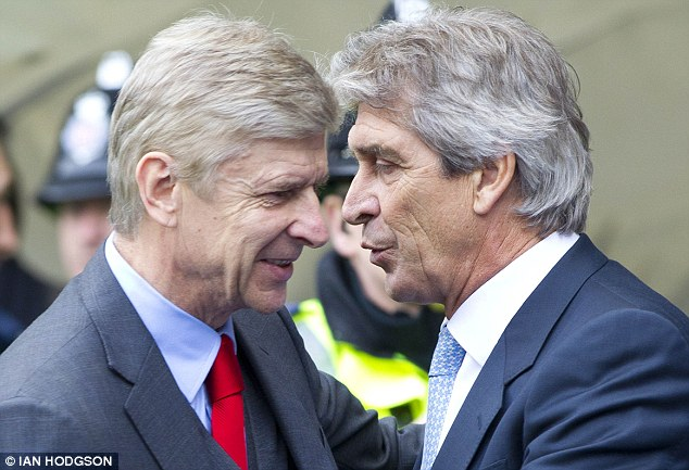 Embrace: Arsene Wenger and Manuel Pellegrini have a chat before the game