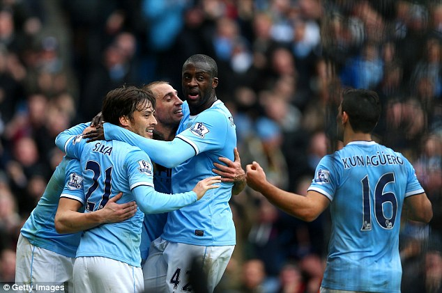Embrace: City celebrate Negredo's goal to give them the lead again