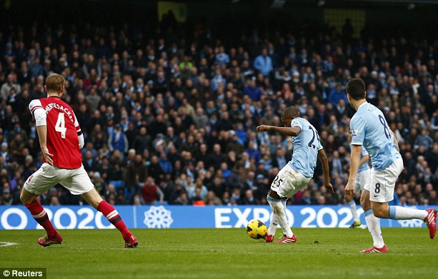 Off the mark: Fernandinho scored his first goal for Manchester City to extend their lead to 3-1