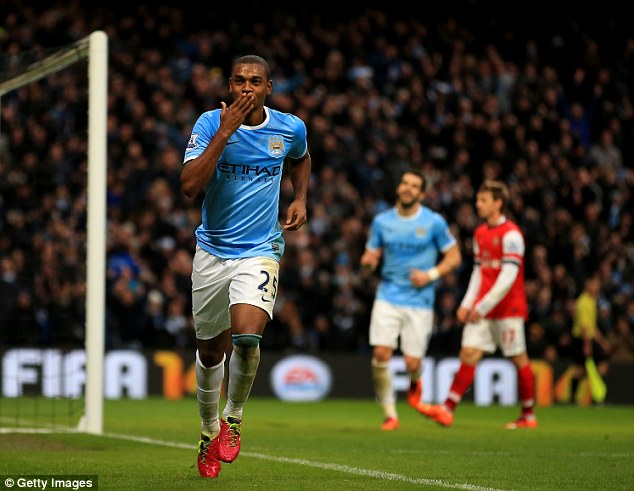 Sealed with a kiss: Fernandinho earner the man of the match award for his excellent display