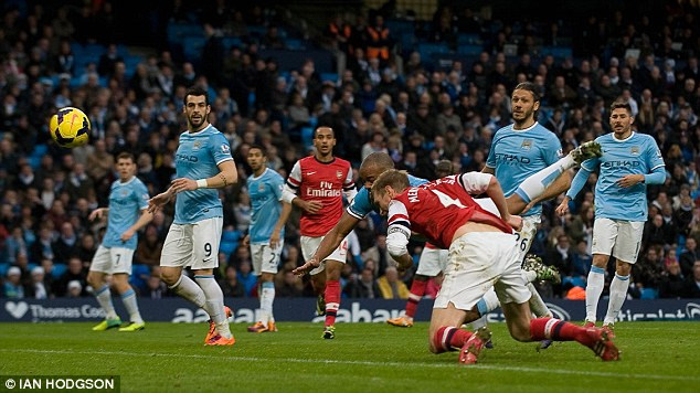 Consolation: German defender Per Mertesacker headed a third goal for Arsenal in injury time