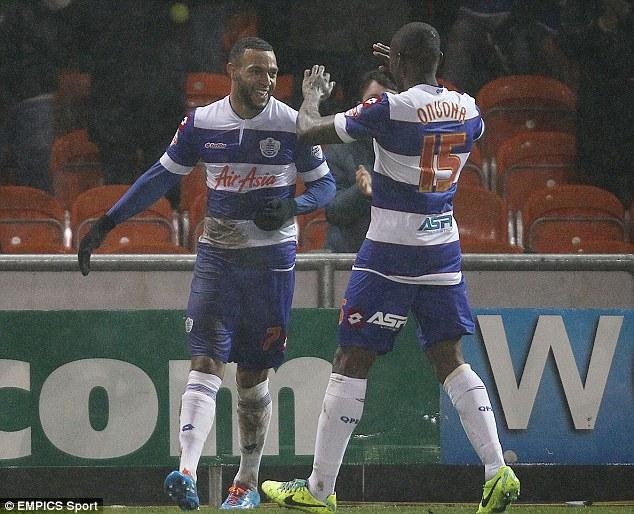 All smiles: Matty Phillips celebrates scoring with team mate Nedum Onuoha