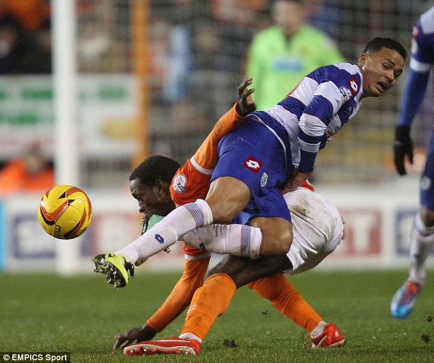 Battle for the ball: Blackpool's Isaiah Osbourne and Queens Park Rangers' Jermaine Jenas fight for possession