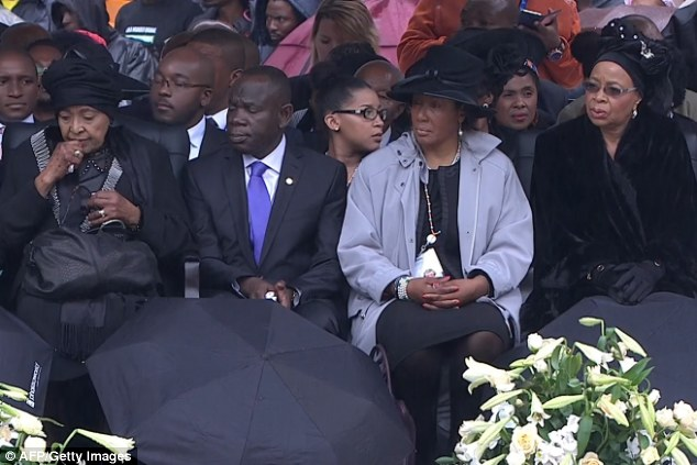 Two kinds of grief: Winnie Mandela Madikizela, far left, and Nelson Mandela's widow Graca Machel, far right, attend the memorial service for late South African President