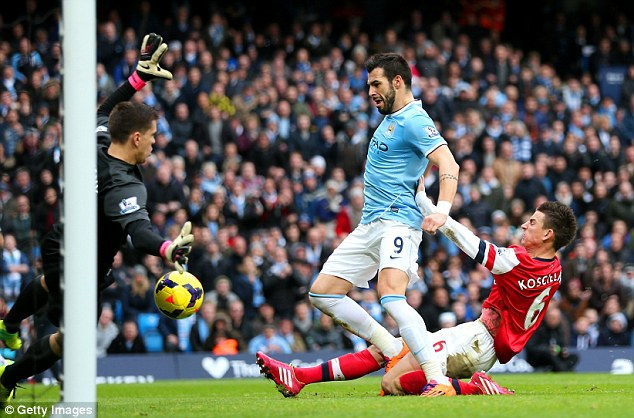 Laceration: Koscielny suffered a 'deep laceration' after colliding with Alvaro Negredo as the striker scored Manchester City's second goal
