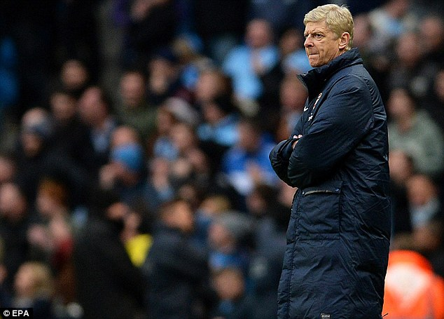 Damaging day: But Arsenal manager Arsene Wenger claims he did not see the incident