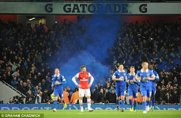 Blue mist: Everton supporters set off a flare after Gerard Deulofeu's late equaliser against Arsenal last Sunday