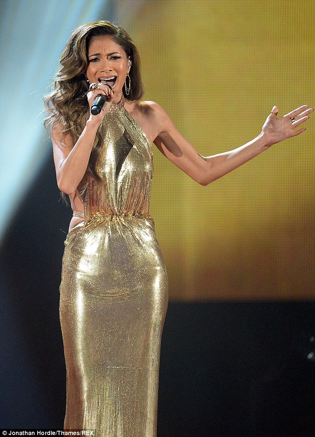 The original diva: Showcasing her impeccable physique once again, the singer's slinky floor-length halterneck gown proved to be yet another style winner