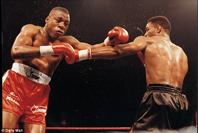 Rare sight: Gary Mason (left) suffered the only defeat of his 38-fight career against Lennox Lewis (right) in 1991 at Wembley Arena