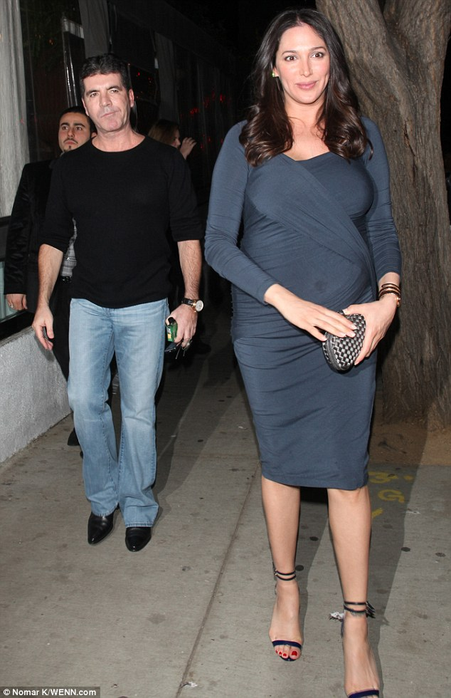 Out of sync: Simon Cowell and heavily pregnant Lauren Silverman appeared to be a few yards apart as they made their way to Los Angeles restaurant Sur on Saturday night