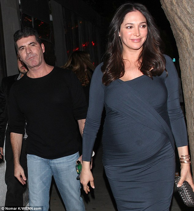Mr and Mrs: But Cowell sports a surly expression while Lauren offers photographers a warm smile