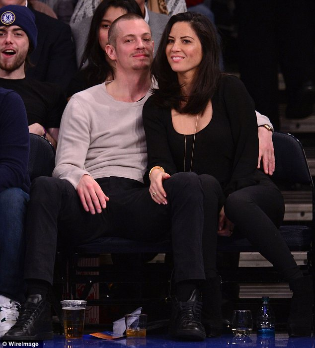 Affectionate: The couple couldn't keep their hands off each other as they took in the Atlanta Hawks vs New York Knicks game at Madison Square Garden