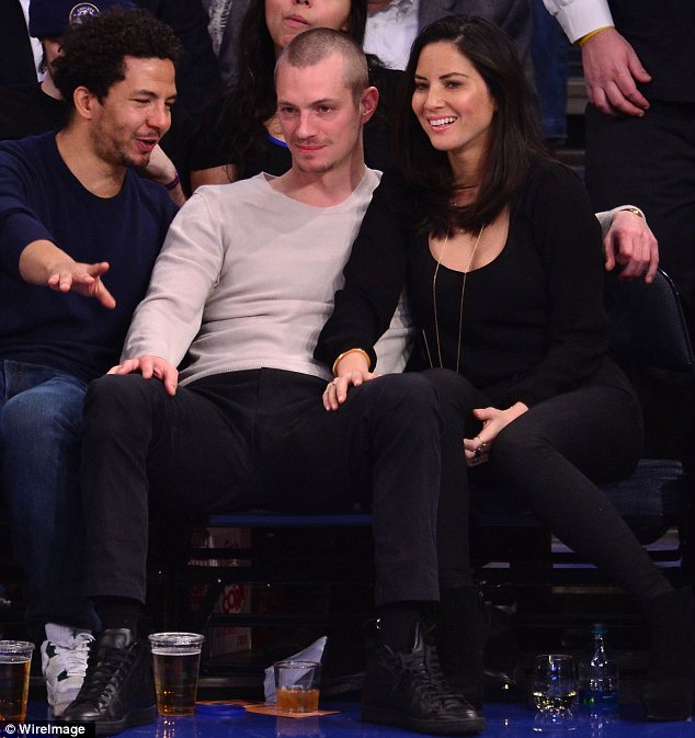 Beautiful: It's not surprising the 34-year-old Swedish actor couldn't keep hands, off Olivia, 33, as the star looked beautiful in her casual outfit of skinny jeans and a long sleeved top