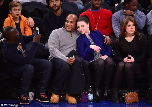 Not enjoying yourself? Britain's Princess Eugenie didn't appear to be having much fun as she sat courtside beside Michelle Trachtenberg