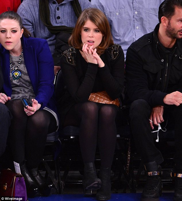 A royal pain: Eugenie didn't seem to be loving her basketball experience and sported a rather glum expression