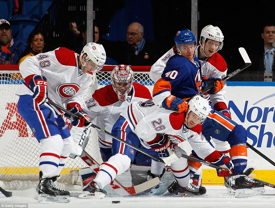 Goalmouth scramble: Montreal Canadiens defend their goal against the New York Islanders during the first period at the Nassau Veterans Memorial Coliseum in Uniondale, New York