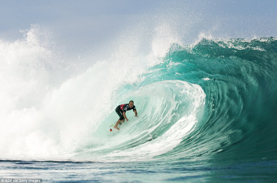 Surf's up: CJ Hobgood of the USA rides a perfect pipeline as he placed equal 9th in the Billabong Pipe Masters in Memory of Andy Irons in Haleiwa, United States