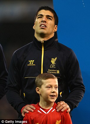 Captain: Luis Suarez before the game as he lead Liverpool out onto the pitch