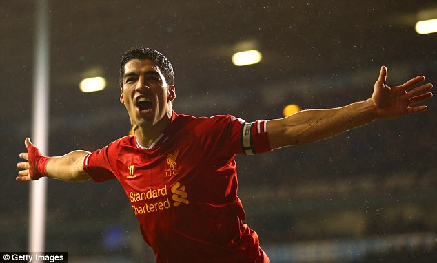Deft touch: Suarez scored his second and Liverpool's fourth with five minutes left