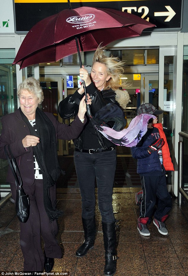 What a wind! Penny Lancaster arrived at Glasgow Airport where she was welcomed by some extreme Scottish weather on Saturday