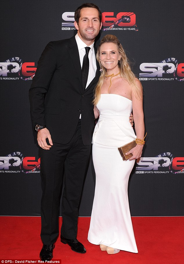 Glamorous: Sailor Ben Ainslie and Georgie Thompson pose for the cameras on the red carpet