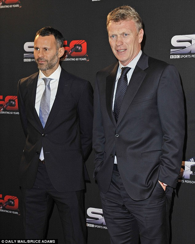 Suited and booted:  Manchester United's Ryan Giggs (left) and his manager David Moyes