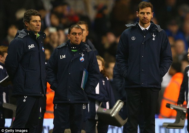 Glum: Andre Villas-Boas looks on his side are thumped 5-0 by Liverpool