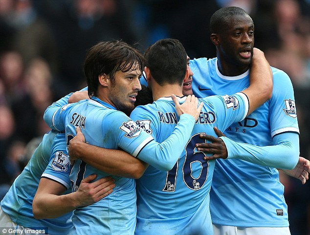 Champions elect? Manchester City, with David Silva (left) and Yaya Toure, put leaders Arsenal to the sword