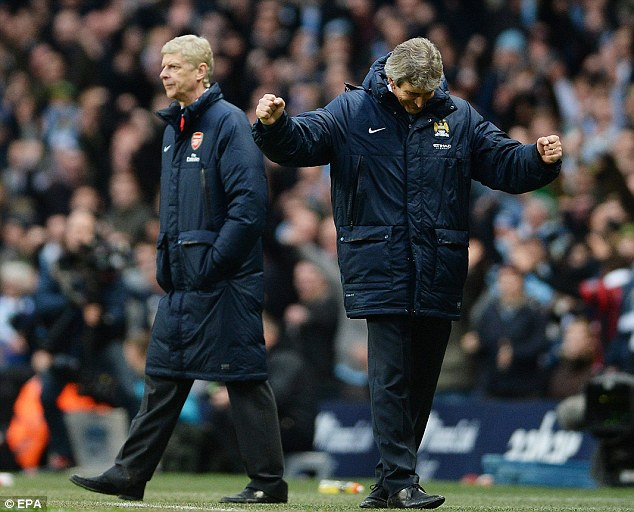 Rollercoaster ride: Manuel Pellegrini (right) was by far the happier of the two managers at the Etihad