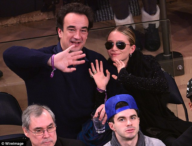 No pictures: The lovebirds playfully mugged for the cameras while at the game