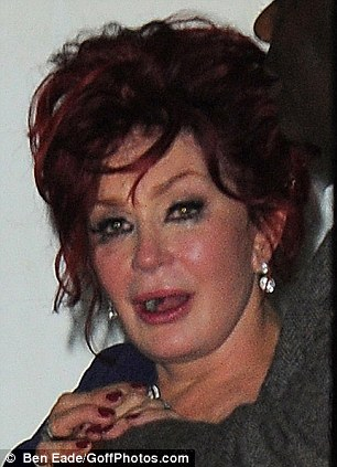 Struggling to control her emotions: The tears could be seen around Sharon's eyes as she headed home from the party