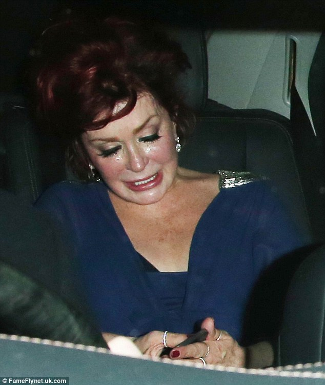 Calm down dear: Sharon Osbourne looked bleary-eyed and tearful as she left the X Factor wrap party at London's One Marylebone at 2.45am on Monday morning