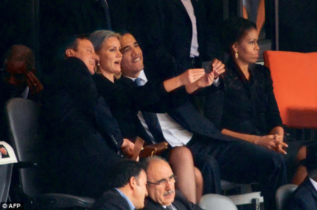 Iconic: One of the most famous selfies from 2013 was taken of U.S. President Barack Obama (right) and British Prime Minister David Cameron by Denmark's Prime Minister Helle Thorning Schmidt (centre) at Nelson Mandela's memorial, pictured