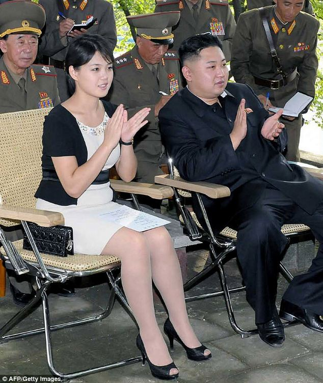 Safety fears: This undated file picture released by North Korea's official Korean Central News Agency shows North Korean leader Kim Jong-Un (right) accompanied by his wife Ri Sol-Ju