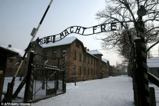 Notorious: Groening was responsible for guarding the possessions of the doomed arrivals as they stepped off the trains bringing them to Auschwitz (pictured) in Poland. He claims he committed no crimes at the complex