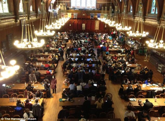Escape: Students are pictured gathering in Annenburg Hall as they awaited updates on Monday