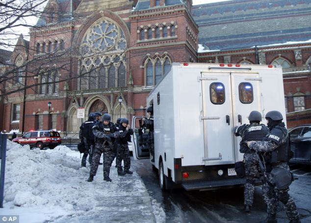 Threat: SWAT team officers arrive at Harvard University in Cambridge, Massachusetts on Monday morning after four campus buildings were evacuated following bomb threats