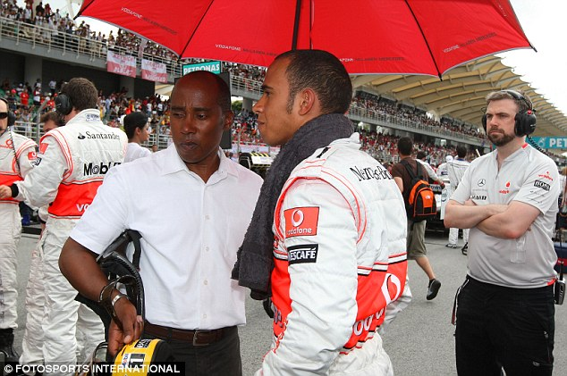 On the track: Anthony Hamilton (left) with his son Lewis ahead of the Malaysian Grand Prix
