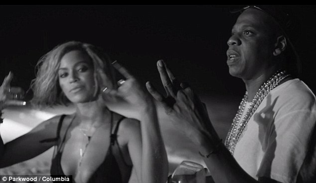 So gangsta: Queen Bey gives her best 'thug' impression as she dances along to Jay's raps, even miming to some of his lyrics