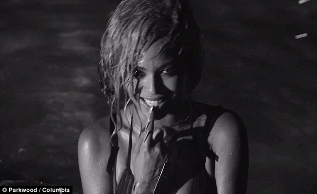 Risque: The star shows off a much sexier side to her personality in the video, which has divided fans