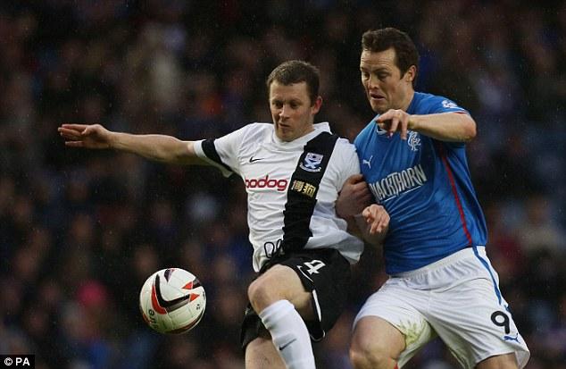 Always a battle: Rangers Jon Daly holds off Ayr's Scott McLaughlin