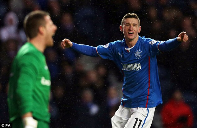 Too easy? Aird celebrates his first goal of the game in Rangers latest victory