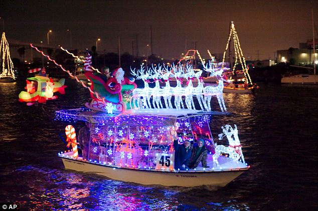 On Dasher! A Santa and his reindeer themed boat cruises across Clear Lake in Kemah, Texas during the 52nd annual League City Chamber of Commerce Christmas Boat Lane Parade on Saturday night