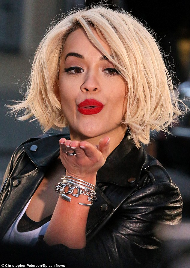 Sealed with a kiss: Rita showcased her bee-stung lips as she pouted away into the camera