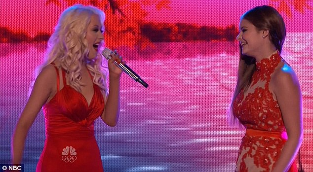 Stunning duet: Christina Aguilera and her singer Jacquie Lee teamed up for a duet during the finals of The Voice on Monday night donning long red gowns