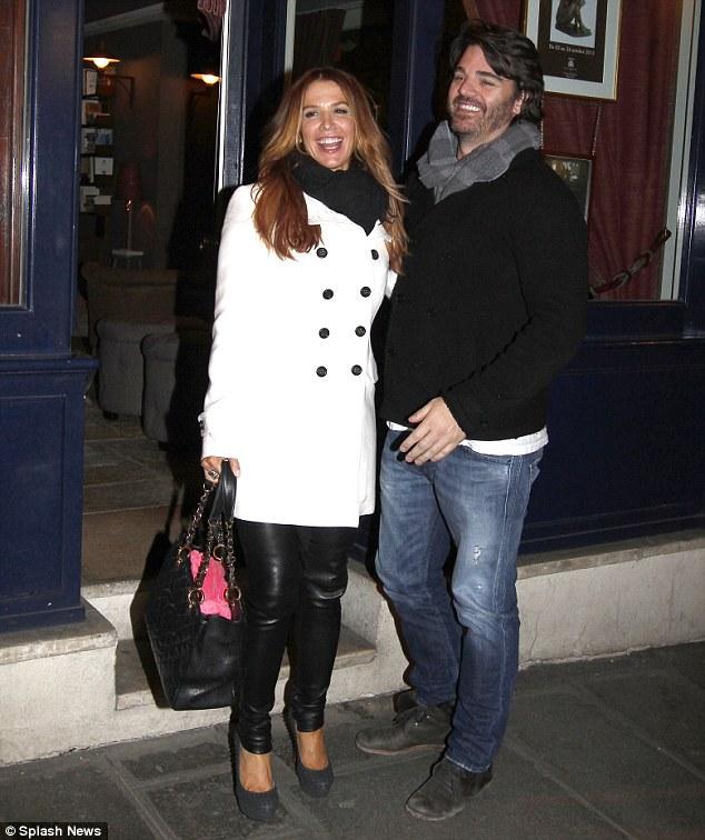 Romantic break: Poppy with partner Shawn Sanford strolling in Paris last week