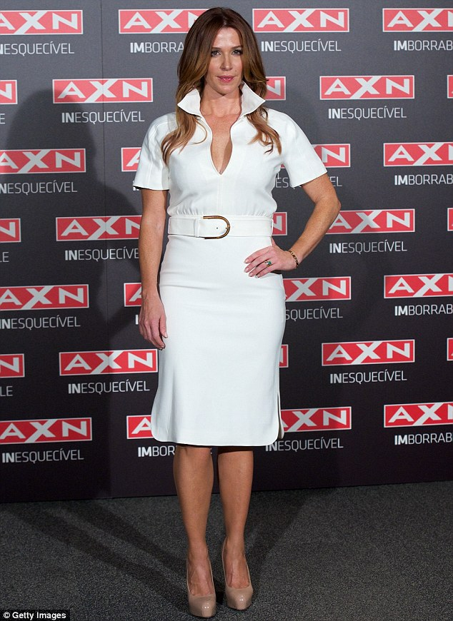 White wonder: Poppy Montgomery arrives at the Unforgettable photocall at the AC Retitro Hotel on in Madrid on Tuesday