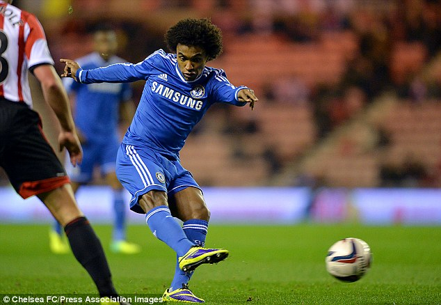 Focus: Brazilian midfielder Willian takes a shot at goal after some clever build-up